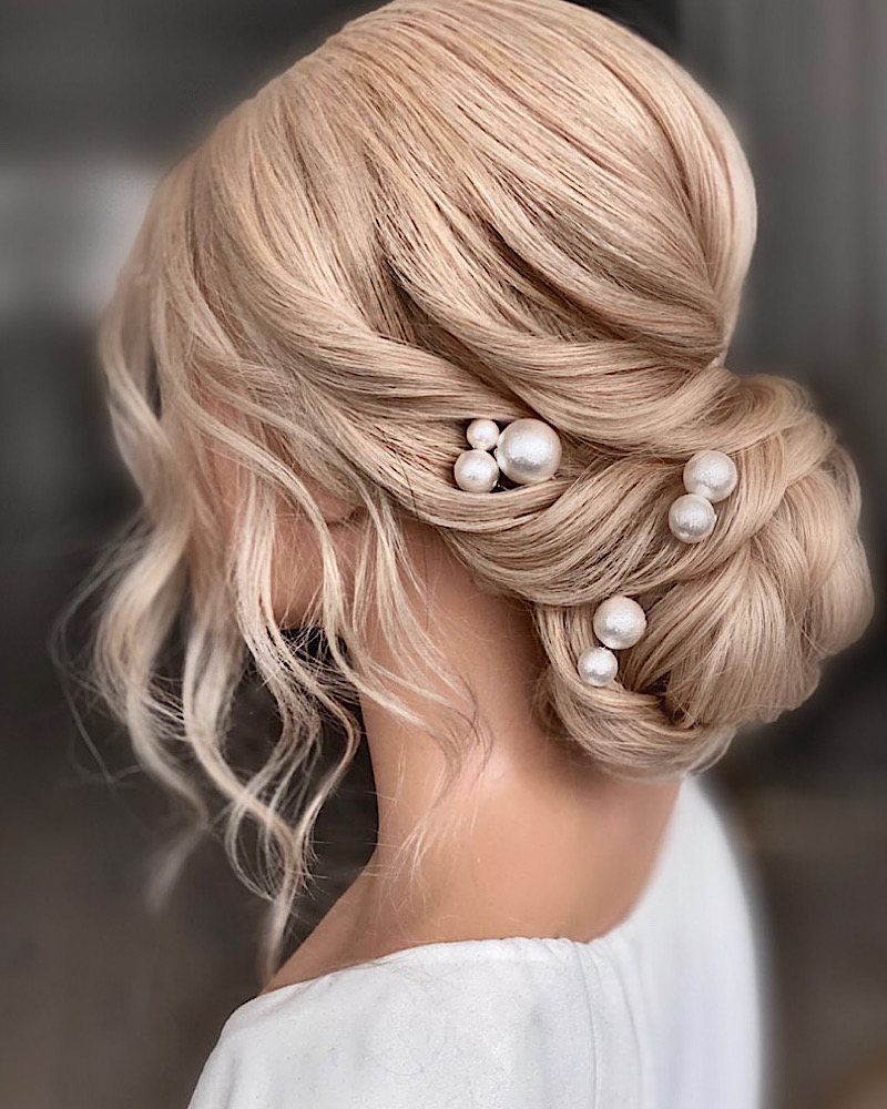 Textured Bridal up do with pearl hair pins